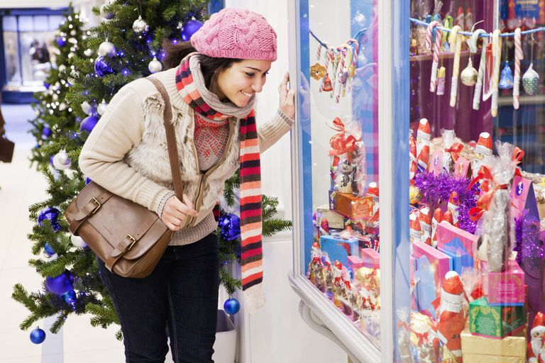 Woman window shopping during the holidays