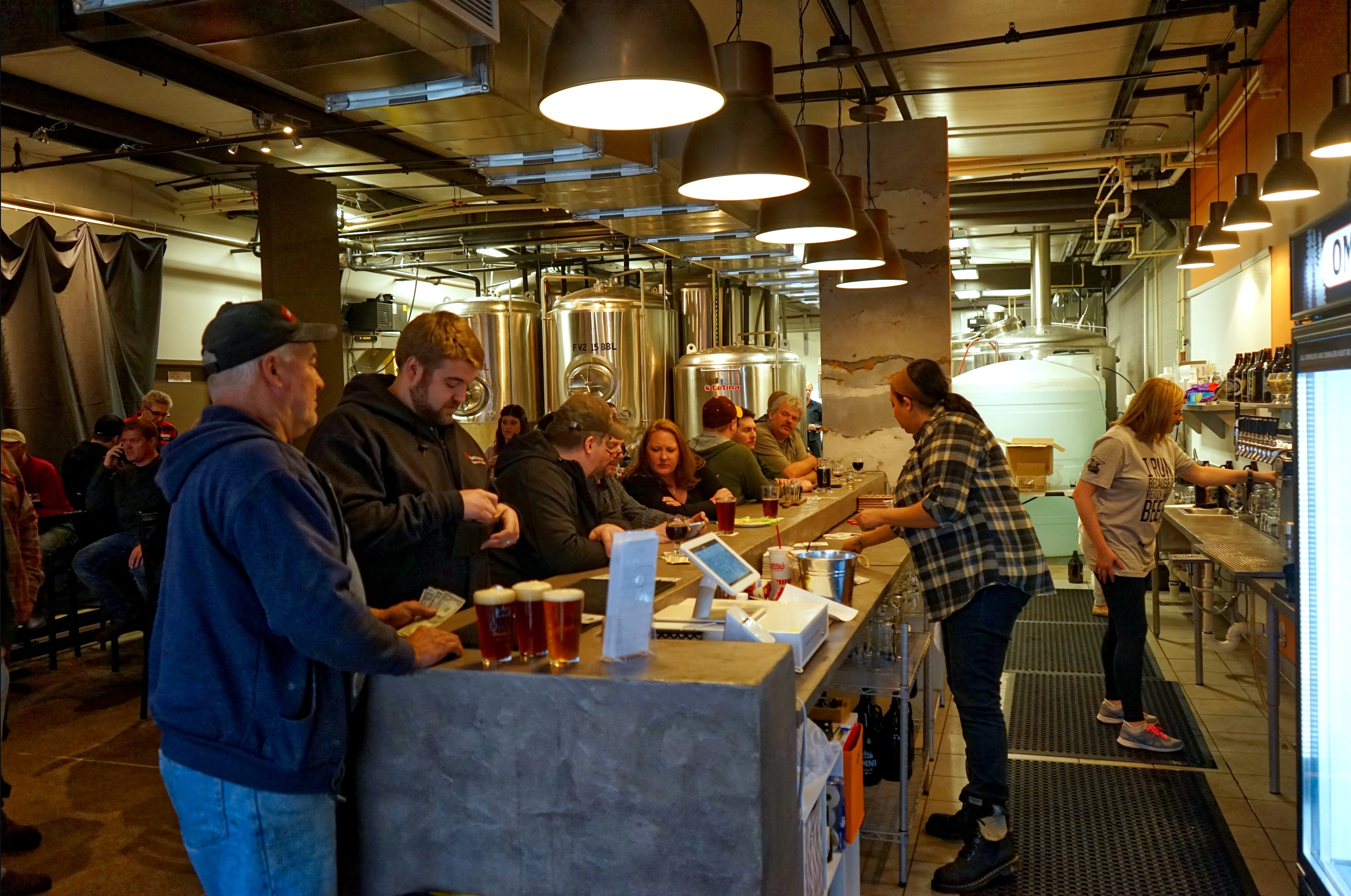 People ordering beers at a brewery