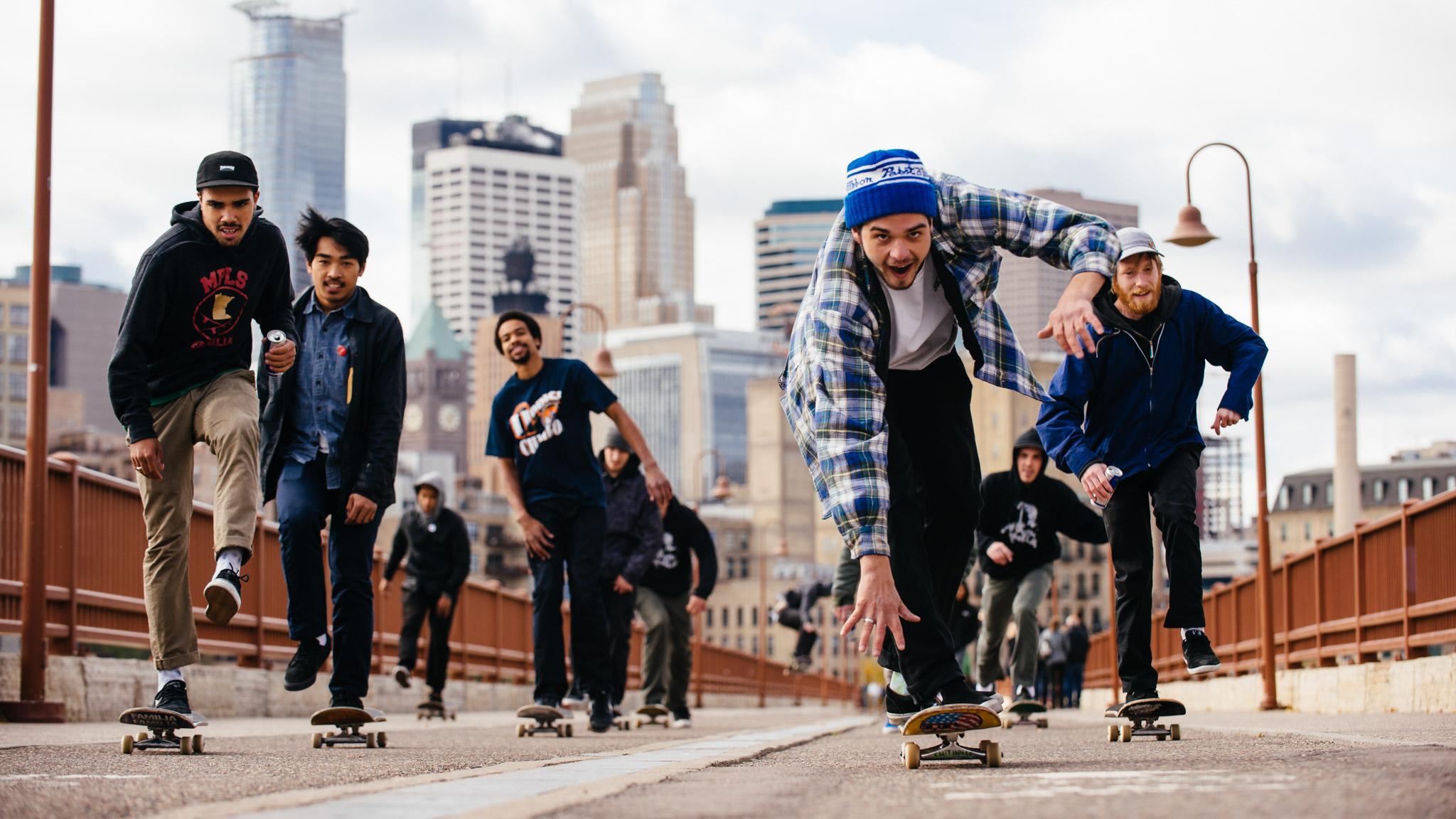 People skateboarding on bridge near downtown Minneapolis