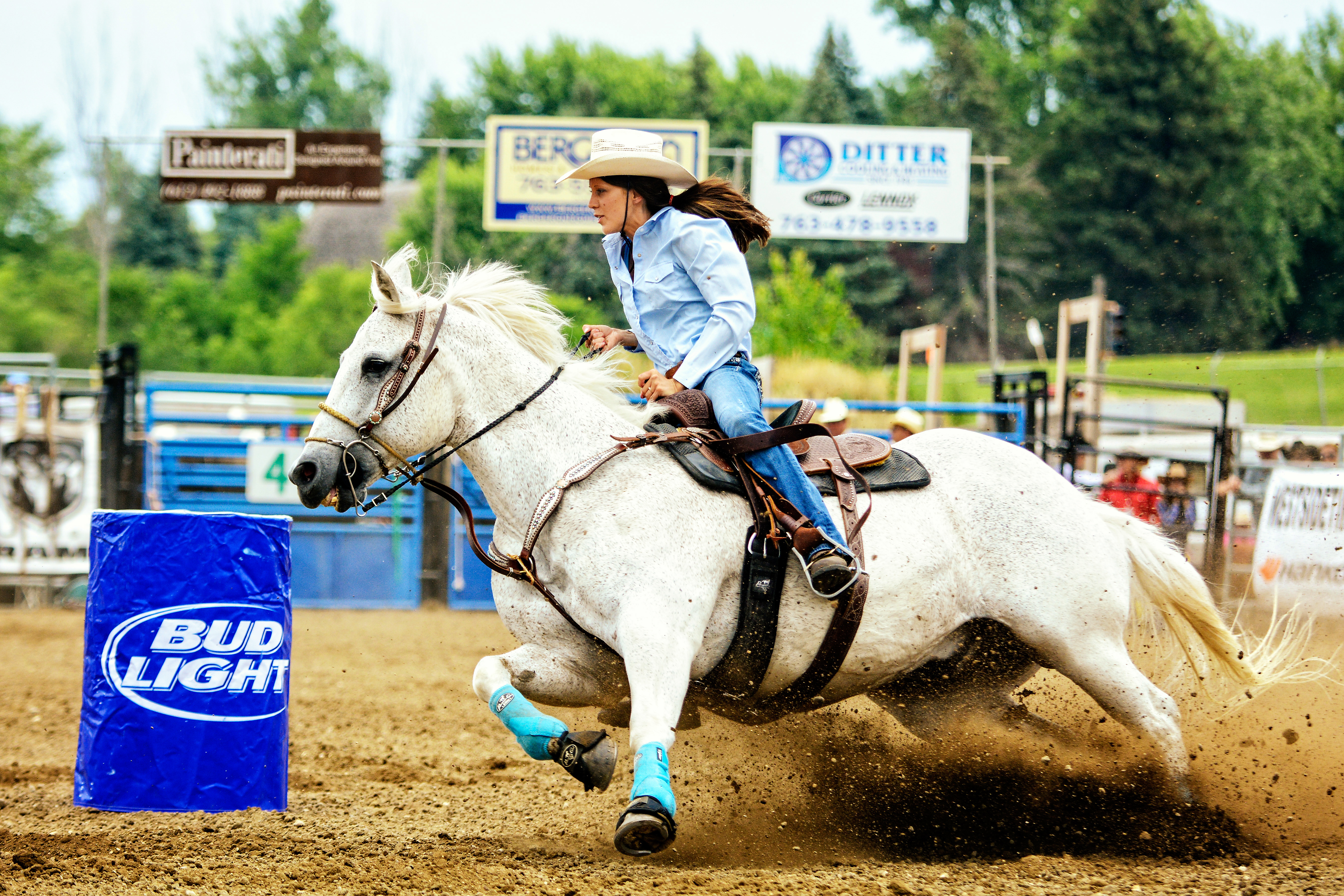 Person barrel riding with a horse