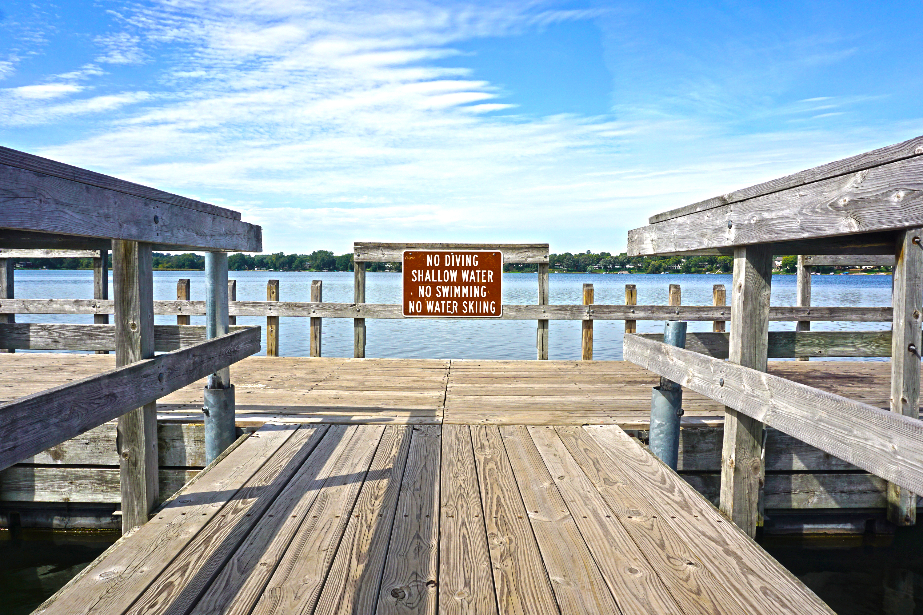 End of dock on a lake
