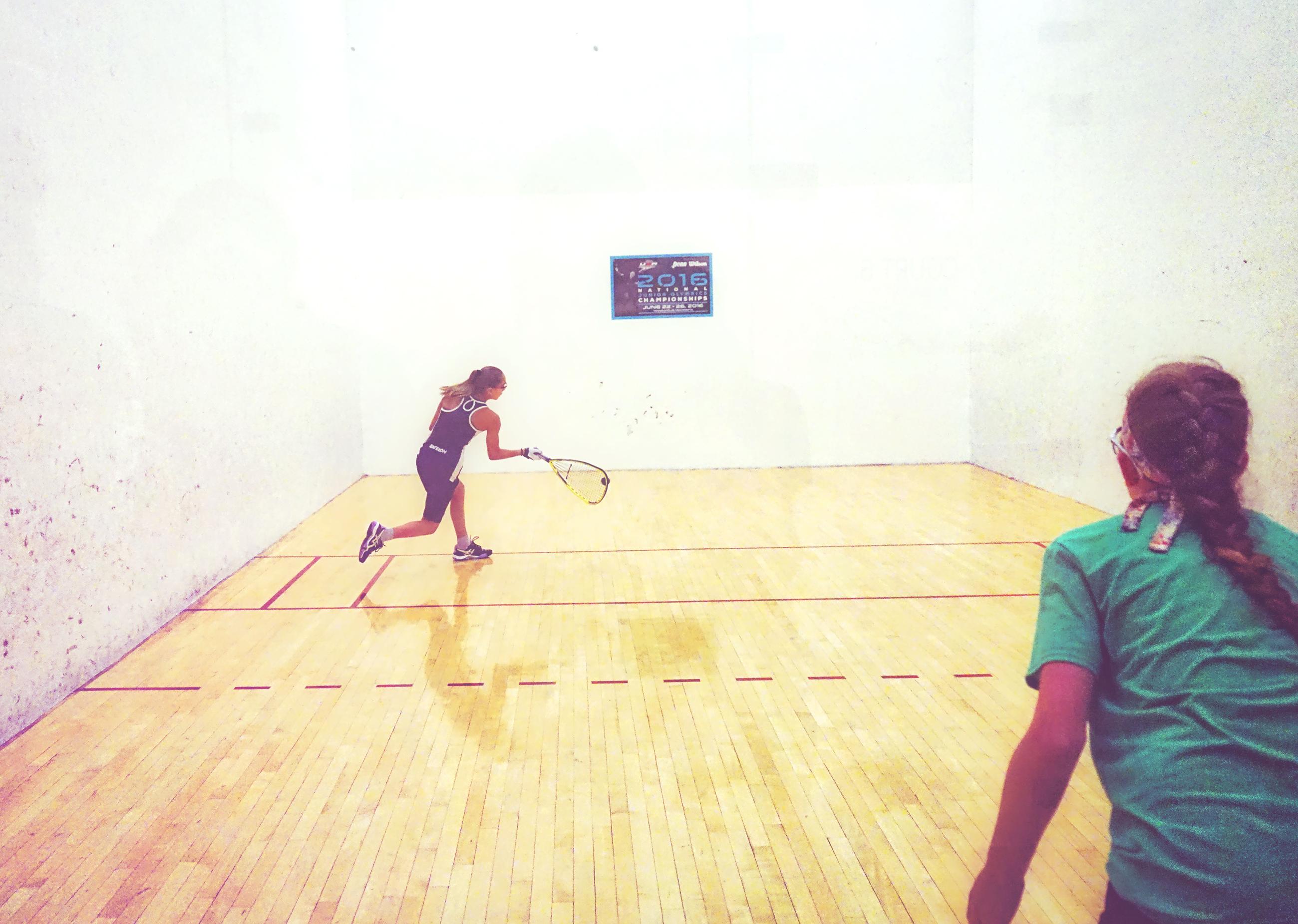 Women playing racquetball