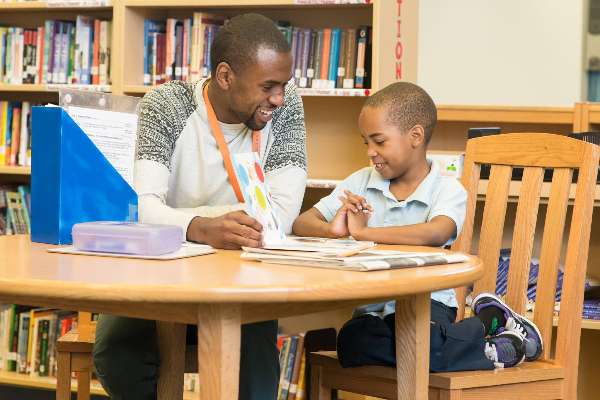 Mentor helping child