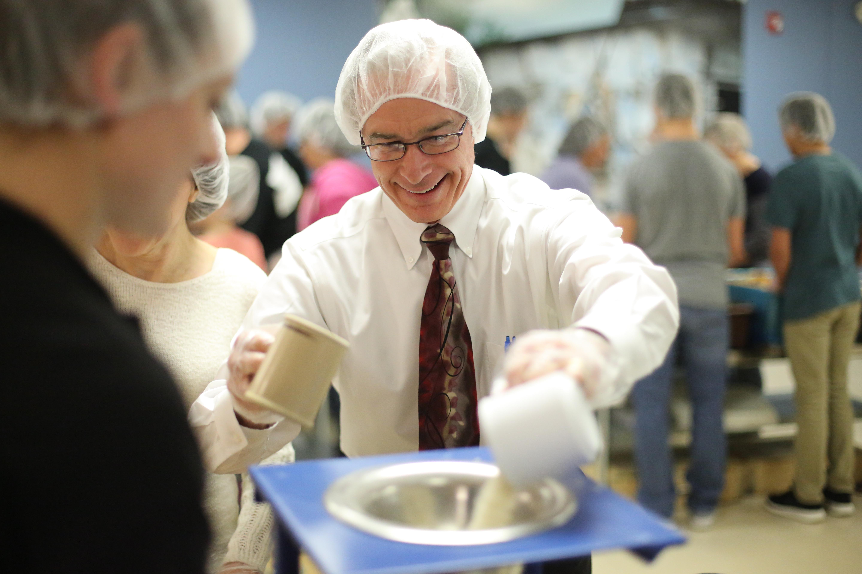 Volunteer serving food at shelter