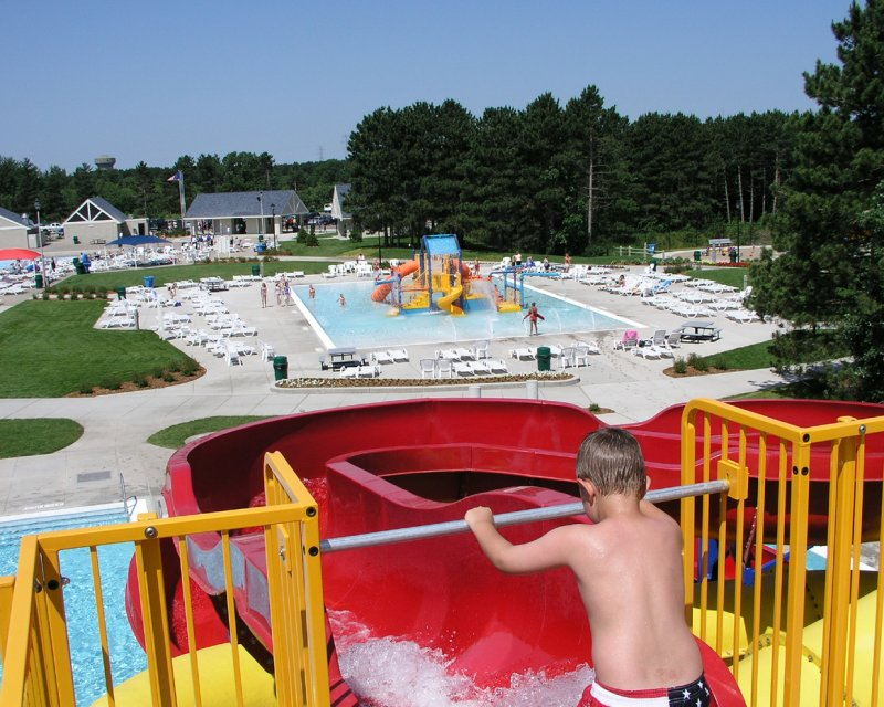 kid going down waterslide at park