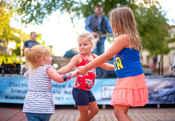 Young girls dancing to live music