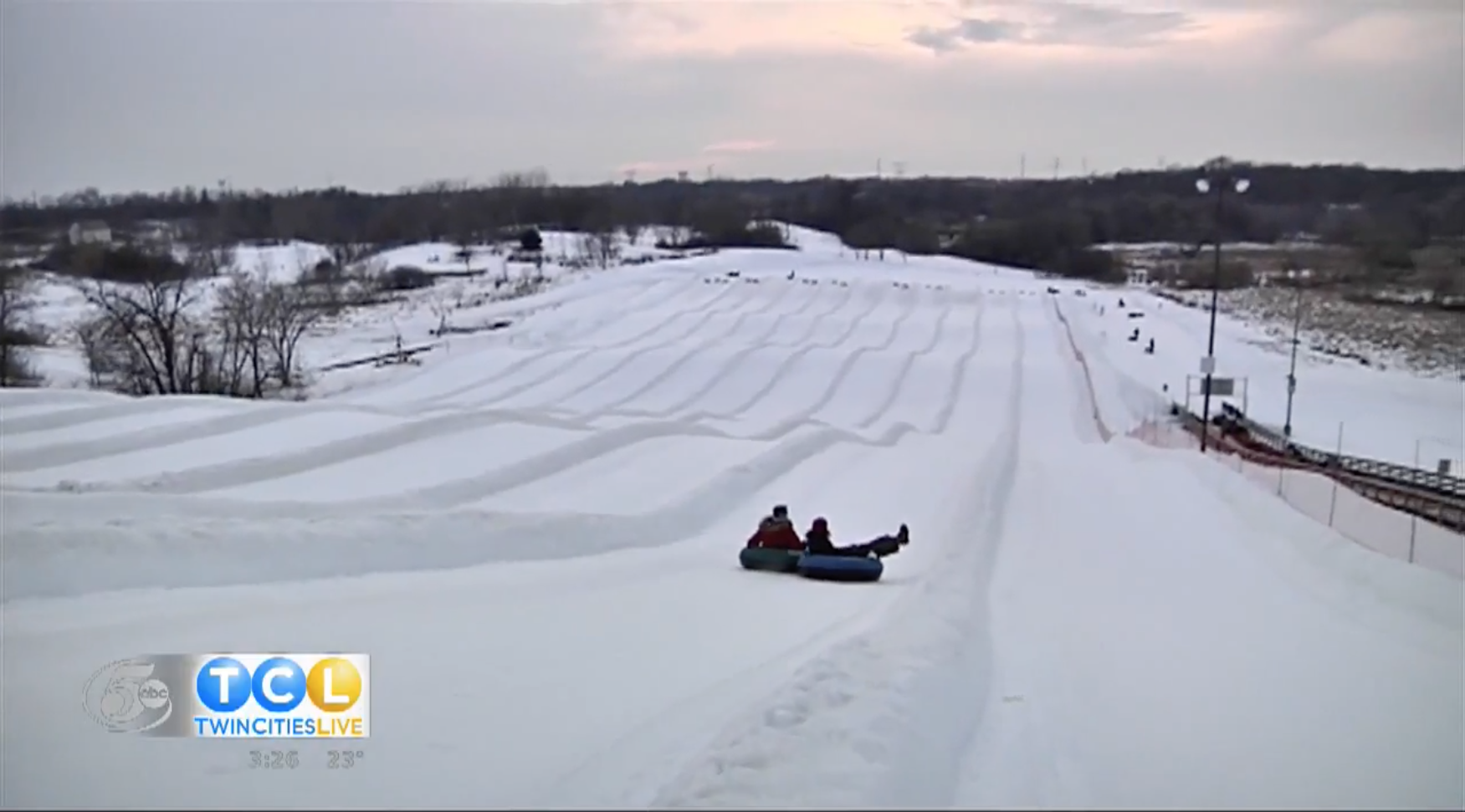 snow tubing down large hill