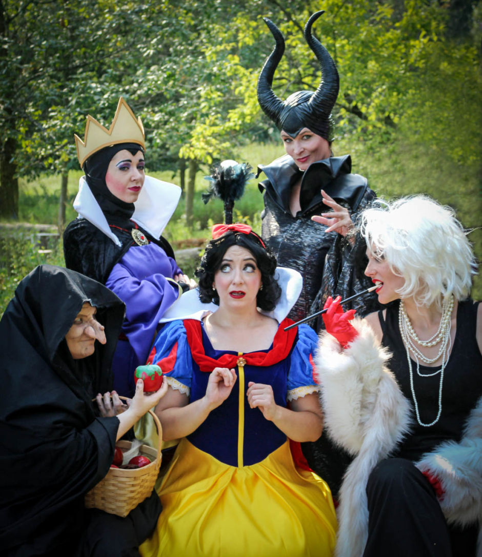 Snow White surrounded by evil witches
