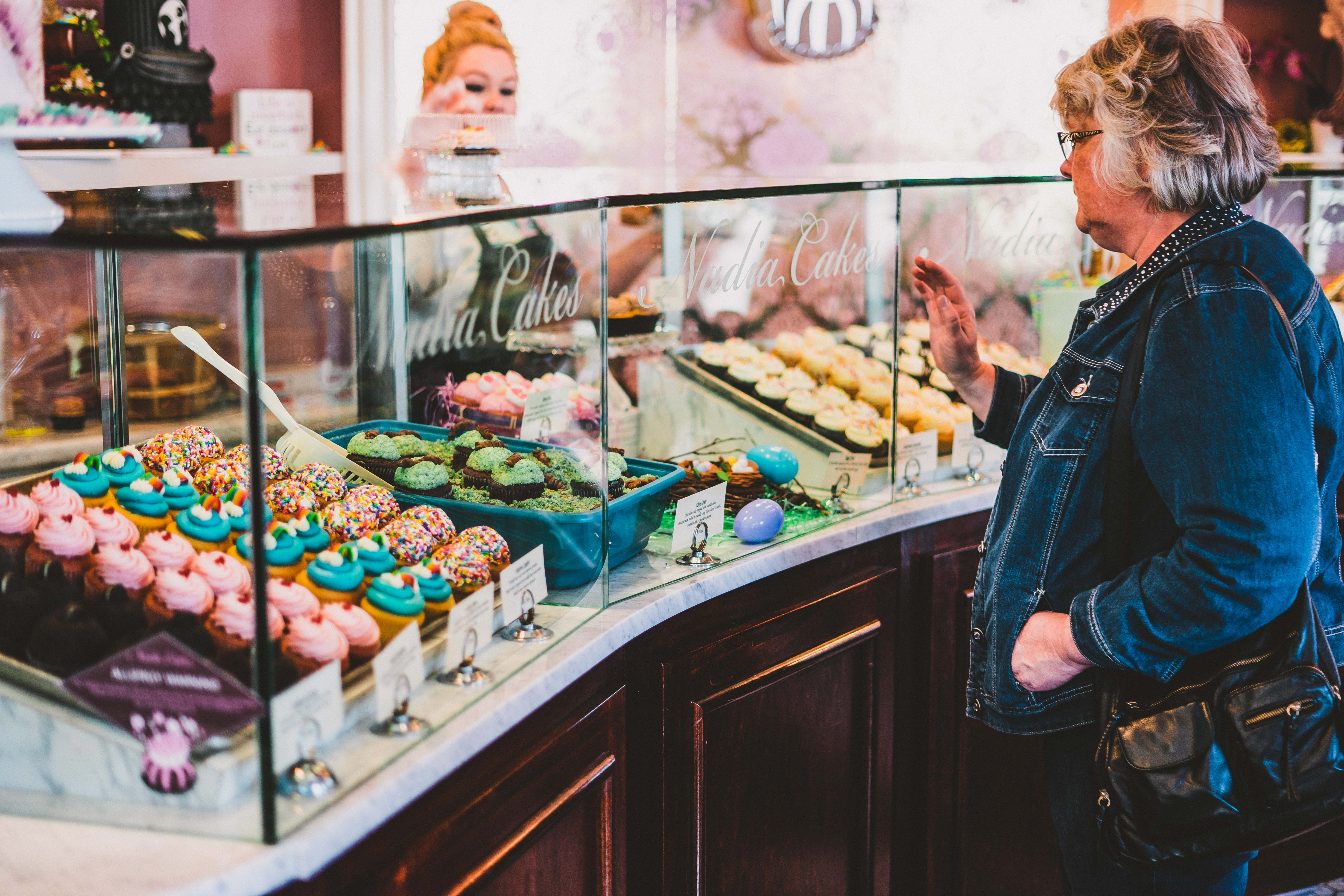 Woman purchasing cupcakes