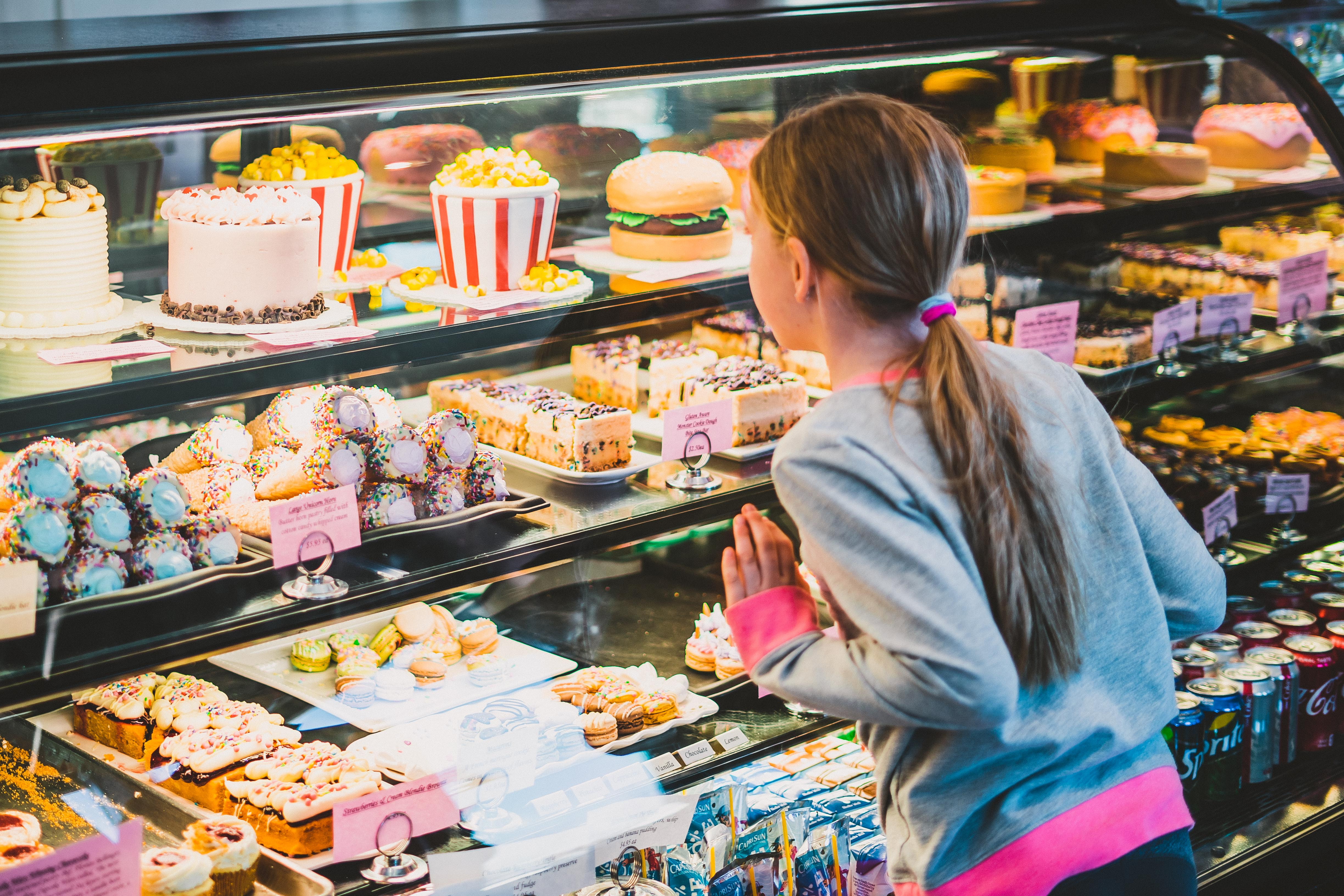 Child looking at treats on display