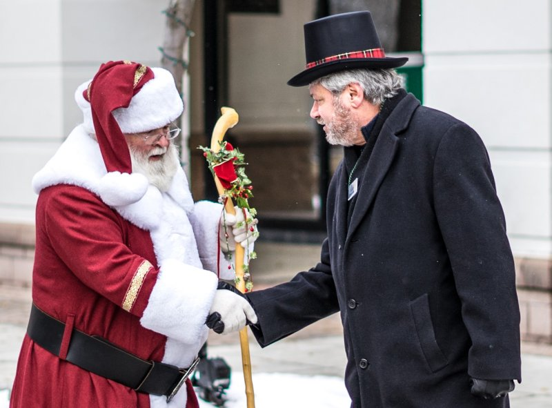 Dave Looby shaking hands with Santa Claus
