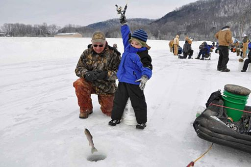 Young boy with Father Winter Ice Fishing