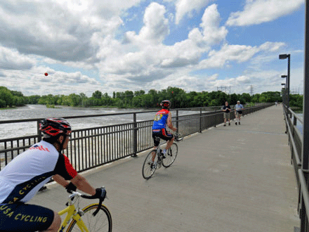 Bicyclist crossing the Coon Rapids Dam