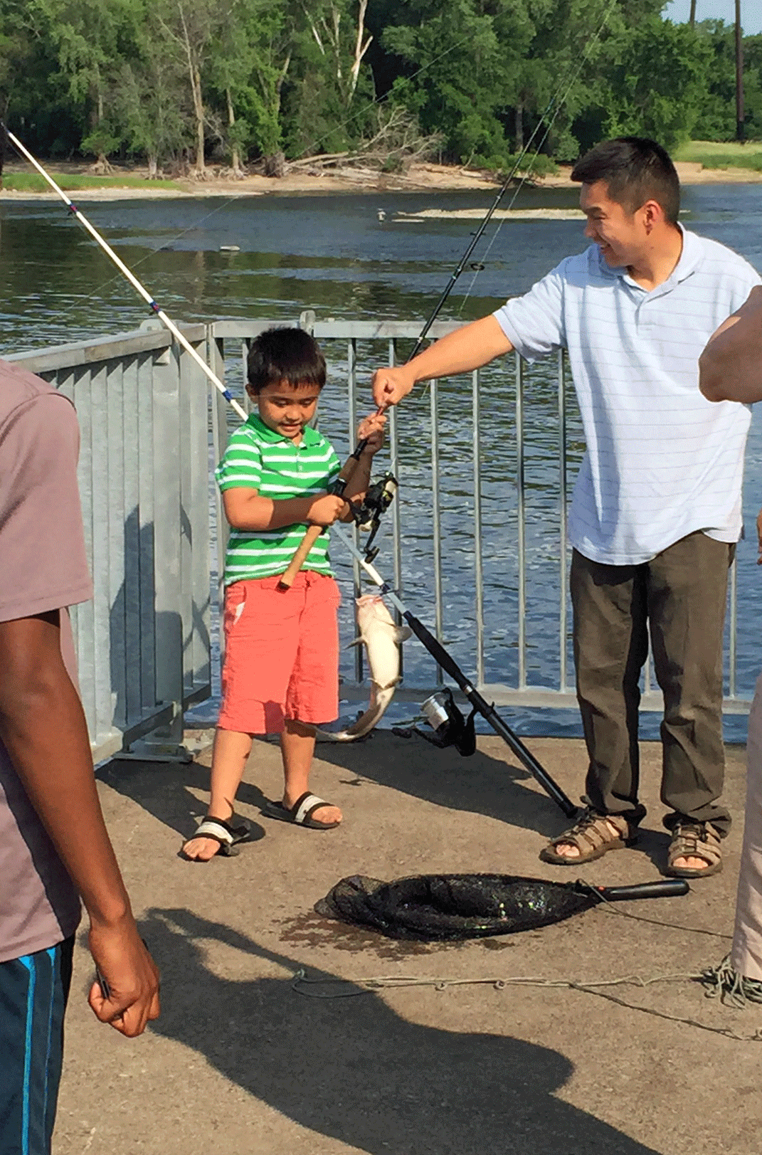 kid holding large fish he caught
